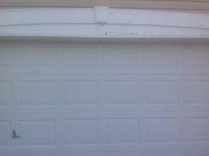 Replace Wood Above Garage Door Cover Photo