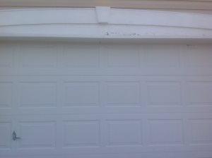 Replace Wood Above Garage Door Cover Photo
