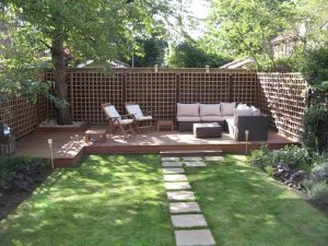 Backyard With BBQ Grill, Fire Pit, Sitting Area Cover Photo