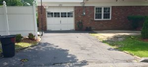 Asphalt Driveway With Stone Edging Cover Photo