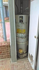 Plumber To Raise Water Heater Cover Photo