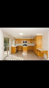 Staining Kitchen Cabinets  Cover Photo