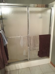 Install Shower Door Cover Photo