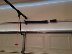 Replace Garage Door Spring Cover Photo