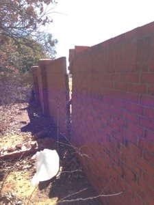 Backyard Brick Wall Cover Photo