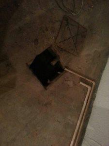Clogged Floor Drain Cover Photo