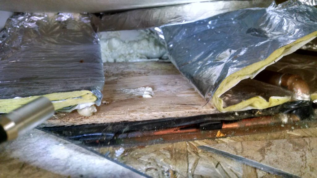 Insulating underneath kitchen cabinets with pipes Cover Photo