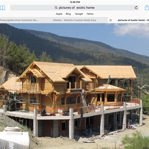 Nu-world Homes And Custom Builders Logo