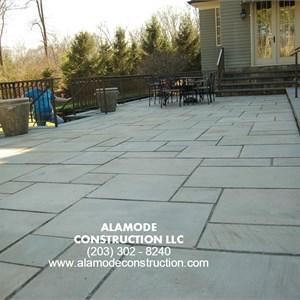 Alamode Construction, LLC Logo