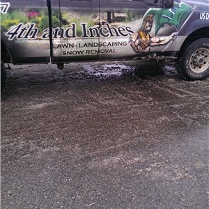 4th and Inches Lawn, Landscaping, and Snow Removal Logo