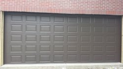 Eli and Mandi Garage Doors INC. Logo
