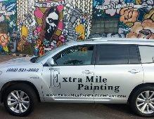 Extra Mile Painting Company Logo
