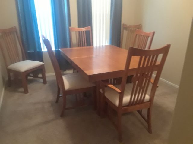 Dinning room table and 6 upholstered chairs.