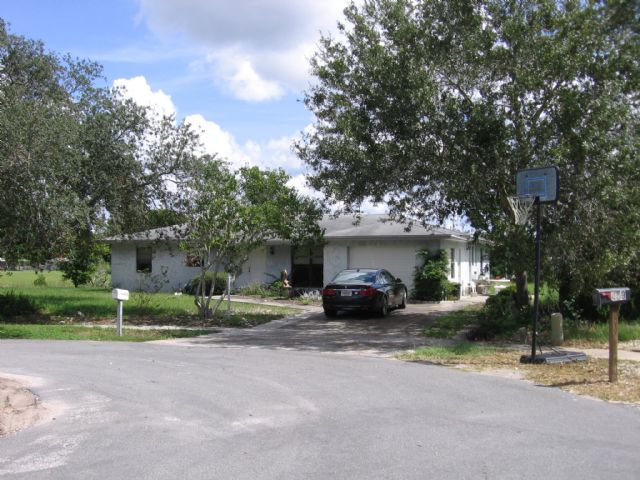 (SOLD) 4/2  on lake in SpringHill, FL $67,500