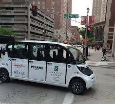 Buzzing around downtown in an electric cab