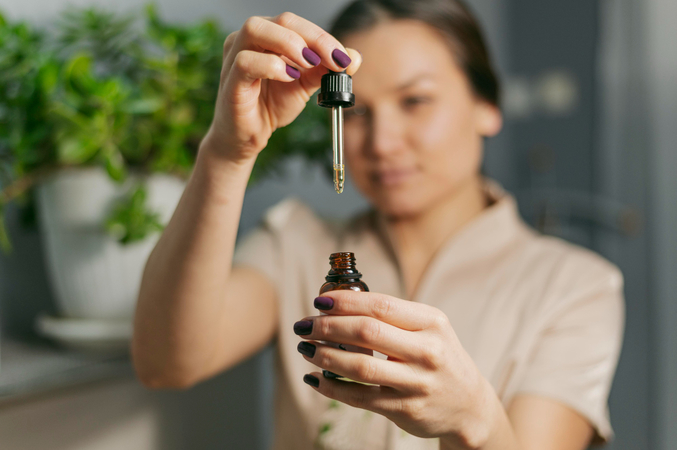 Therapist with serum bottle