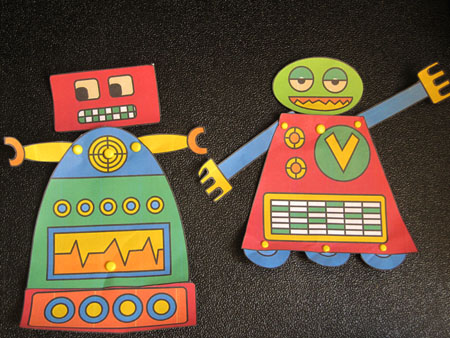 robots made of paper and brads