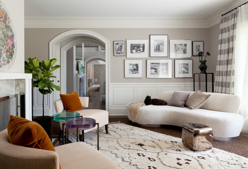 Casual living room with armless white sofa white patterned rug wood
