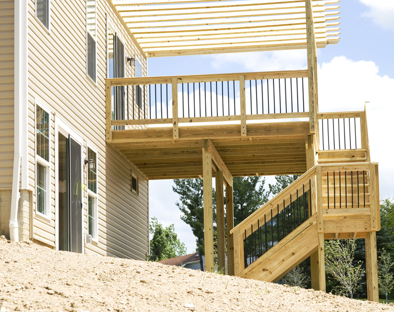 Elevated Covered Sundeck With Stairs Leading Down Into The