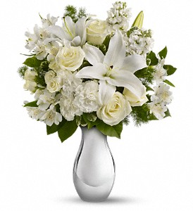 The gorgeous bouquet includes white roses, white spray roses, white oriental lilies, white alstroemeria and white stock accented with assorted greenery.