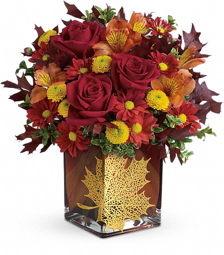 Brighten their home and heart this Thanksgiving with a lush fall bouquet of lilies, carnations and mums presented in a stunning artisanal container. Sure to become a treasured year-round décor piece, the hand-glazed ceramic vessel makes a lovely vase or an artistic kitchen utensil holder.