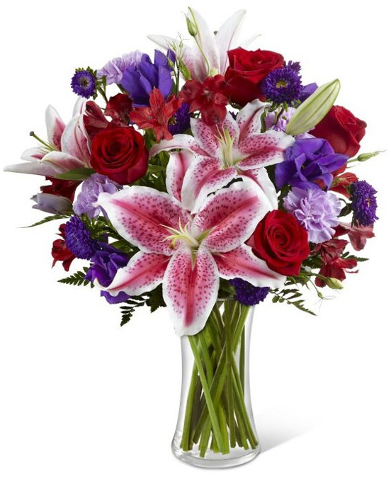 The Stunning Beauty Bouquet is an absolutely lovely way to send your love and affection. Fragrant and very popular Stargazer lilies stretch their star-like petals across a bed of rich red roses, lavender carnations, red Peruvian lilies, purple double lisianthus, purple matsumoto asters and lush greens. Presented in a classic clear glass vase, this elegant bouquet is an incredible way to convey your sweetest sentiments.  To insure perfection, contents may vary but overall look will  remain.