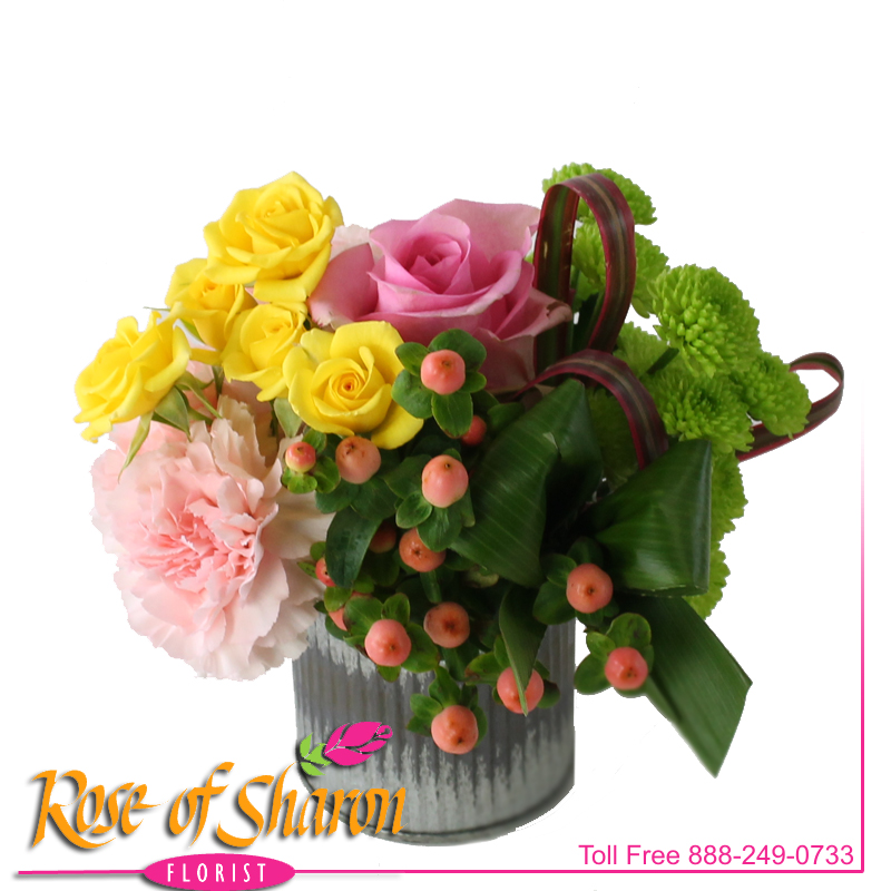 Our sweet Miki Bouquet is fresh for Spring - vibrant yellow spray roses, soft peach Hypericum, Kermit Button Mums and sweet, fragrant Dianthus in our corrugated Zinc container.