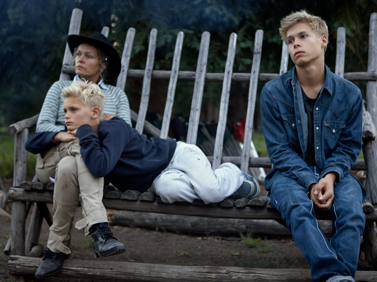 """Frederikke, Oliver and Rasmus listening to John, the """"grizzly magnet""""."""