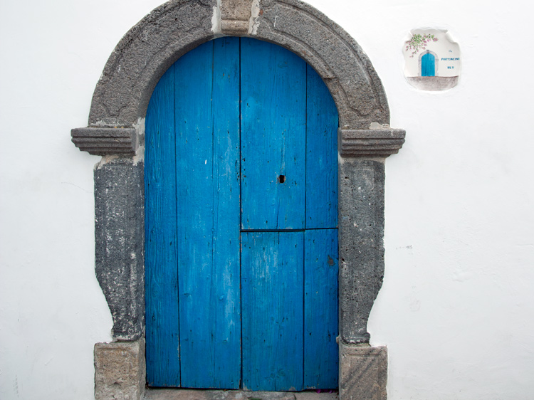 A doorway as blue as the sea on Panarea.