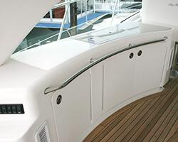 Bent Acrylic Doors and Corian Countertop
