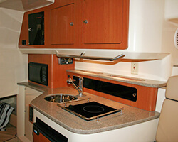 Upper and Mid Galley Cabinets with Corian Countertops and Trim