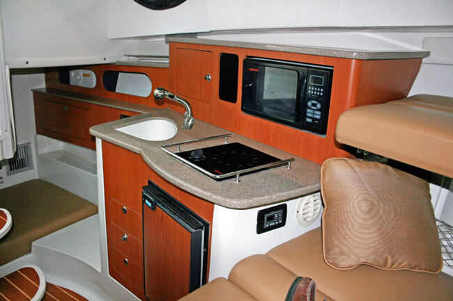 Teak isle products marine solid surface parts for Boat kitchen cabinets