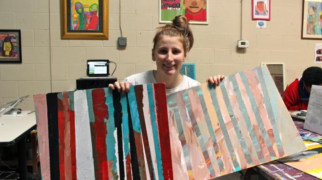 Emily Aussem with artwork