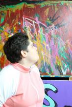 "Rebecca looking at painting ""Dinosaurs Having Fun."""
