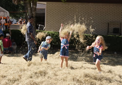 Showers of straw are created as youngsters play in the Pumpkin Patch at Tallahasee Heights United Methodist Church in Florida.