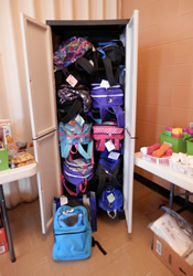 Supply-stuffed backpacks from the Kids' Junction at First United Methodist Church in Galax, Va., virtually fall out of the closet as they await distribution of children in need.