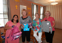 Children's ministry directors from First United Methodist Church in Galax, Va., and Kids' Junction volunteers show some of the new and gently used clothes distributed. From left are Sara Gearhart, Jackie Cockerham, Elsie Davis and Linda Murphy.