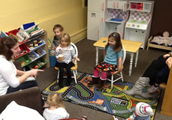Weekly story time draws children and parents to Jubilattee Coffeehouse at Tigard United Methodist Church in Oregon.