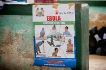 An educational poster on the dangers of the Ebola virus hangs in the community center at the Jaiama Bongor Chiefdom, outside Bo, Sierra Leone. Photo by Mike DuBose, UMNS.