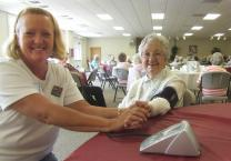 A nurse volunteer takes blood  pressures during a WelcomeTable event organized by Givens LifeMinistries at Mills River near Asheville, N.C. Photo courtesy Shelia Mlz.