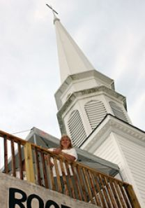 The Rev. Faith Weedling on a platform on top of Brosville United Methodist Church to raise funds for Imagine No Malaria. Photo by Neill Caldwell, Virginia Conference of The United Methodist Church.