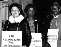 African American and Hispanic American orkers on strike against Kellwood (Little Rock, Arkansas circa 1966-1967) wearing placards that encourage support for better wages. Unknown photographer. International Ladies Garment Workers Union Photographs (1885-1985)Photo courtesy Wikimedia Commons.