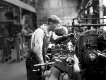 Midvale Company mechanic, Larson, working on a machine at Thomas Steel, July 1932. Courtesy of the Kheel Center for Labor-Management Documentation and Archives