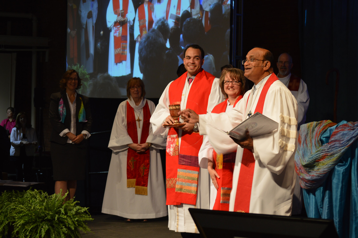 Bishop and new clergy prepare to serve communion