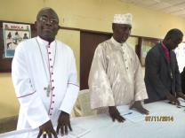 (From left)  Archbishop Tamba Charles of the Freetown Archdiocese of the Roman Catholic Church in Sierra Leone; Sheik Abubakar Conteh , president of inter- religious council of Sierra Leone,  and  United Methodist resident bishop, John K. Yambasu,  chairman of the religious leaders task force,  stand together at a July 11 press conference. Photo by Phileas Jusu, UMNS; Photo by Phileaus Jusu, UMNS