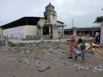 The church building of Port-Bouët 2 - Derrière Wharf Nouvelle Jérusalem United Methodist Church(New Jerusalem United Methodist Church) in Côte d'Ivoire, was partially destroyed by a government project to build a larger road. Despite the damage, church members continue with Sunday worship on Sept. 28, 2014. Photo by Isaac Broune, UMNS