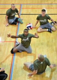 Wounded, ill and injured current and former members of the military compete in a sitting volleyball tournament in the Pentagon gym.
