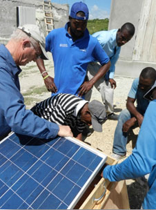 Installing the components of a solar-powered cart.