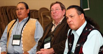 Reginald Killsnight, Sr., David Halaas and Otto Braided Hair listen during a dialogue about the Sand Creek Massacre.