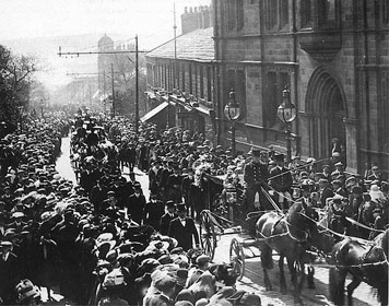 A crowd of 40,000 lined the streets of Colne, England, to witness the May 18, 1912, funeral procession of Titanic band leader Wallace Hartley. A web-only photo/public domain.